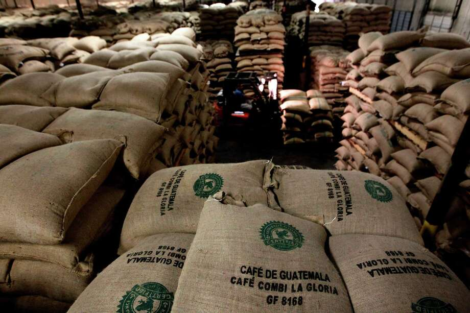 "The amount of coffee beans coming into the Port of Houston appears to be rising along with the price of coffee itself. Most of the shipments, like these from Guatemala, are ""green"" - as the unroasted beans are called. Photo: Mayra Beltran / © 2012 Houston Chronicle"