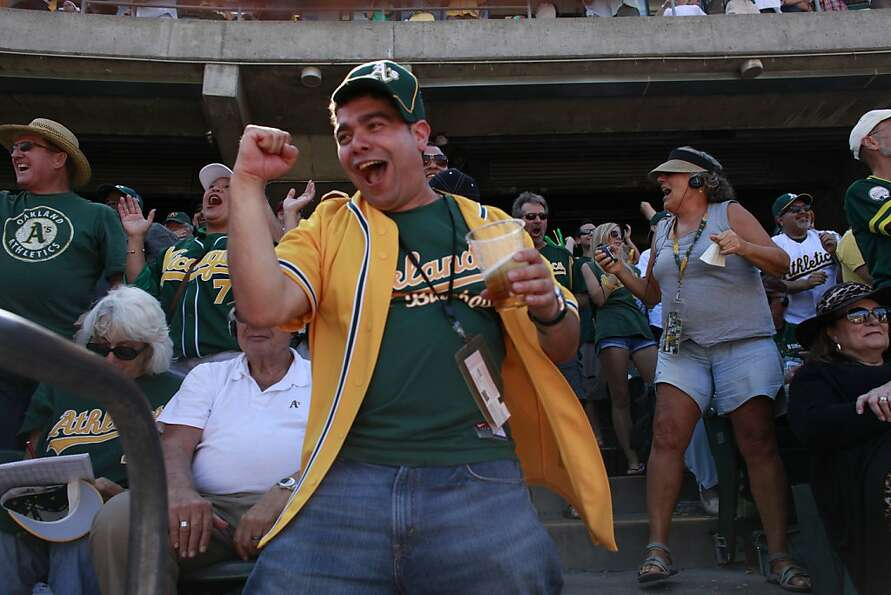 Jose Ibara, of Mountain House, Calif, runs up and the down the stands as the Oakland A's score their