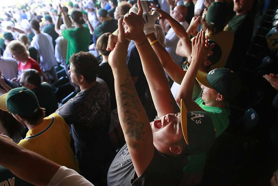 Germain Ulloa, of San Pablo, Calif., cheers during as the Oakland As add a third run in 8th inning  against the Texas Rangers to win the American League Western Division title in a three game sweep against the Texas on Wednesday Oct. 3, 2012. Final score was 12-5. Photo: Mike Kepka, The Chronicle