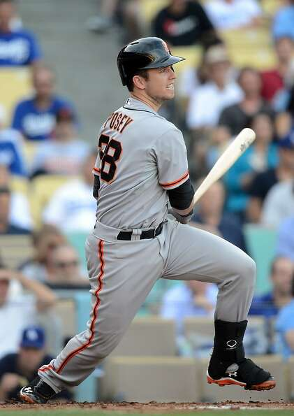 LOS ANGELES, CA - OCTOBER 03:  Buster Posey #28 of the San Francisco Giants grounds out to score Mar
