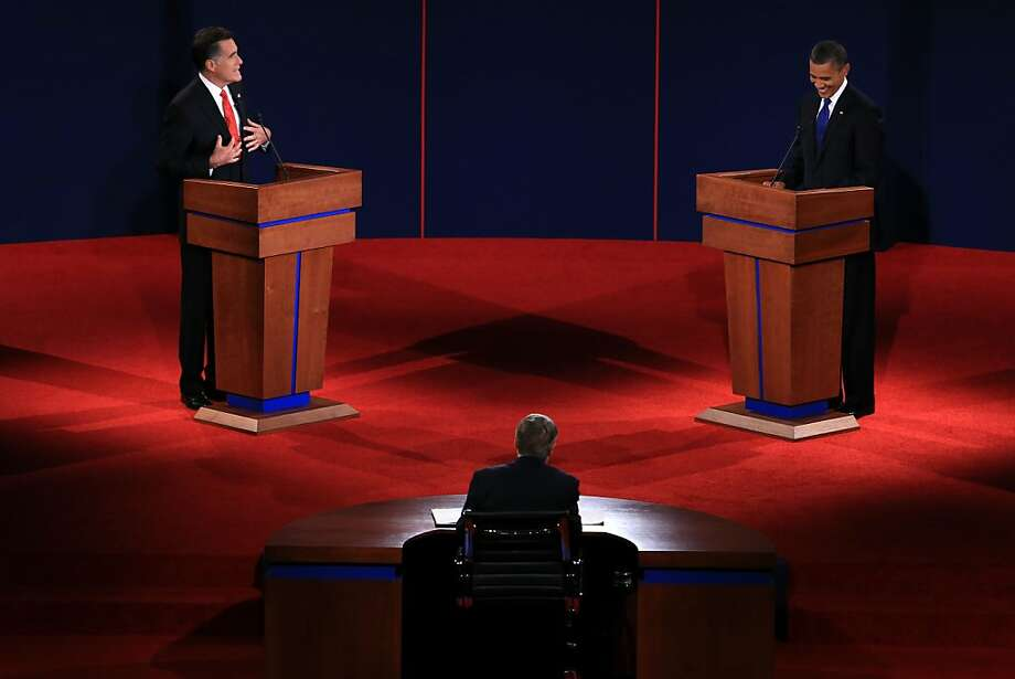 DENVER, CO - OCTOBER 03:  Republican presidential candidate, former Massachusetts Gov. Mitt Romney (L) speaks as Democratic presidential candidate, U.S. President Barack Obama (R) listens during the Presidential Debate at the University of Denver on October 3, 2012 in Denver, Colorado. The first of four debates for the 2012 Election, three Presidential and one Vice Presidential, is moderated by PBS's Jim Lehrer and focuses on domestic issues:  the economy, health care, and the role of government.  (Photo by Doug Pensinger/Getty Images) Photo: Doug Pensinger, Getty Images