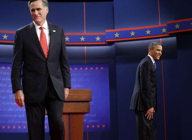 Republican presidential candidate Mitt Romney and President Obama walk to their podiums for the start of the first of three campaign debates. Photo: Pablo Martinez Monsivais, Associated Press