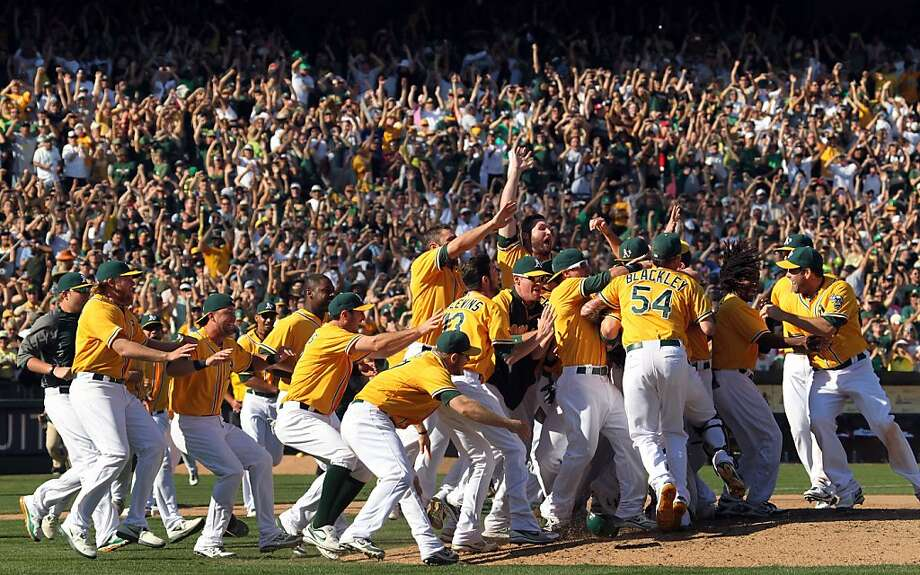 Oakland Athletics celebrate their 12-5 championship win over the Texas Rangers Wednesday October 3, 2012 in Oakland California Photo: Lance Iversen, The Chronicle