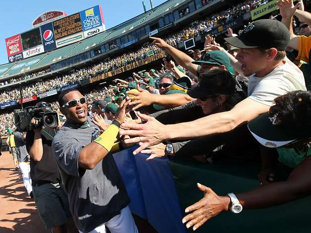 Oakland Athletics Yoenis Cespedes celebrates with the fans afet the A's defeated the Texas Rangers 12-5 for the AL-West championship  Wednesday October 3, 2012 in Oakland California Photo: Lance Iversen, The Chronicle
