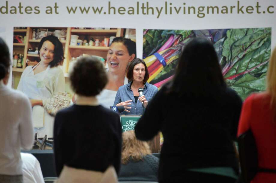 Healthy Living founder Katy Lesser, center, holds a news conference updating plans for a new natural and organic food market and cafe to open in early 2013, in the Wilton Mall Wednesday Oct. 3, 2012. .(John Carl D'Annibale / Times Union) Photo: John Carl D'Annibale / 00019448A
