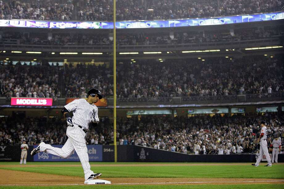 New York Yankees' Robinson Cano (24) runs the bases after hitting a two-run home run during the fifth inning of a baseball game as Boston Red Sox relief pitcher Clayton Mortensen, right, looks away, Wednesday, Oct. 3, 2012, in New York. Photo: Frank Franklin II