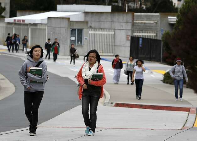 In this file photo, students walk through the main CCSF campus in San Francisco. Photo: Paul Chinn, The Chronicle