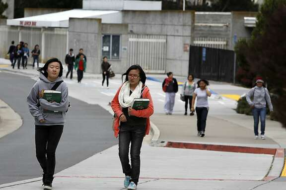 Students walk through the main CCSF campus in San Francisco, Calif. on Friday, June 29, 2012.