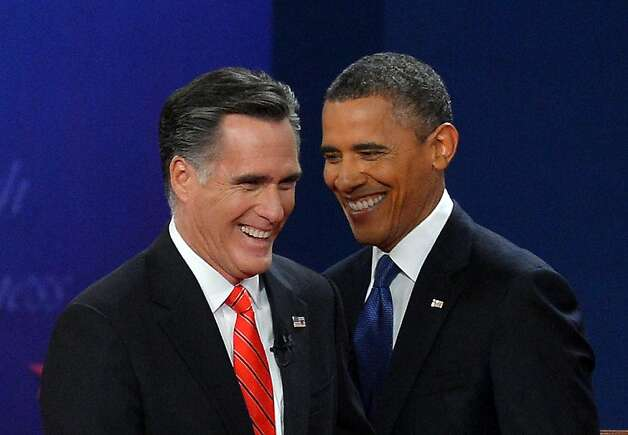 US President Barack Obama (R) and Republican presidential candidate Mitt Romney smile after the first presidential debate at the university of Denver on October 3, 2012 in Denver, Colorado. AFP PHOTO/Jewel SamadJEWEL SAMAD/AFP/GettyImages Photo: Jewel Samad, AFP/Getty Images
