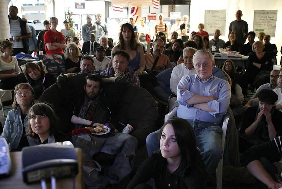 People gather at San Francisco Democratic Party headquarters to watch the debate between President Obama and Republican Mitt Romney. Photo: Lacy Atkins, The Chronicle