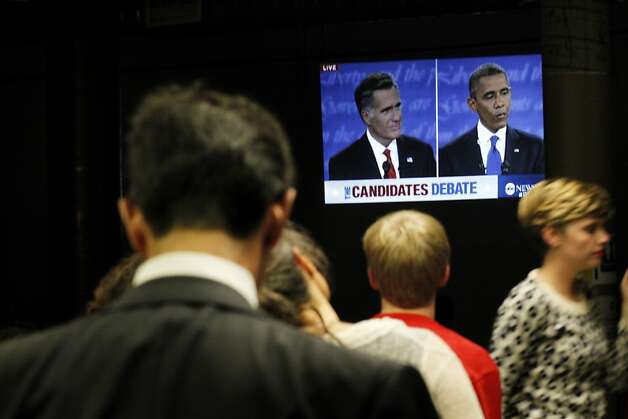 People watch President Barack Obama and Mitt Romney in the first Presidential debate, at the San Francisco Democratic Headquarters, Wednesday October 3, 2012, in San Francisco, Calif. Photo: Lacy Atkins, The Chronicle