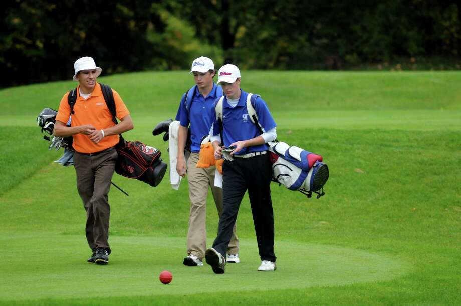 Bethlehem's Vincent Fox, left, walks with Shaker's David Jensen, center, and Saratoga's Calvin Beckwith  during the Section II Class A golf championship on Wednesday, Oct. 3, 2012, at Town of Colonie Golf Course in Colonie, N.Y. (Cindy Schultz / Times Union) Photo: Cindy Schultz / 00019228A