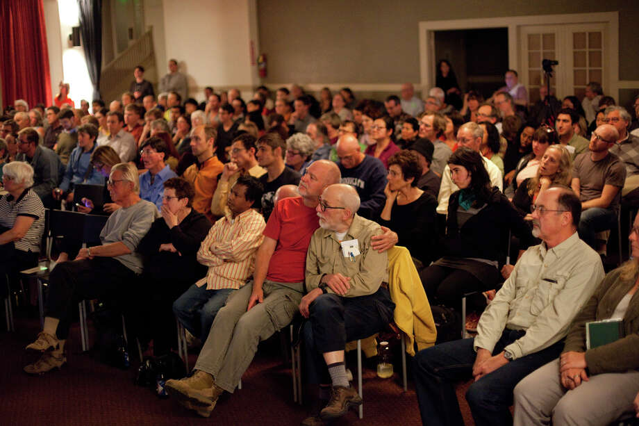 People watch during a debate watching party on Wednesday, October 3, 2012 at Town Hall Seattle in the First Hill neighborhood. Hundreds came out to the event at Town Hall. Photo: JOSHUA TRUJILLO / SEATTLEPI.COM