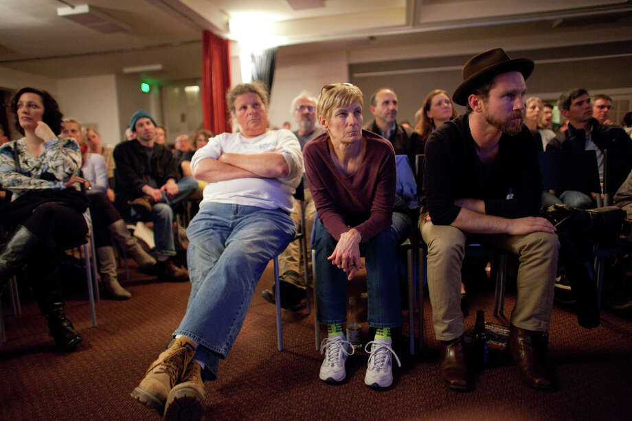 From left, Betsy Shedd, Sylvia Shiroyama and Max McSimov watch during a debate watching party on Wednesday, October 3, 2012 at Town Hall Seattle in the First Hill neighborhood. Hundreds came out to the event at Town Hall. Photo: JOSHUA TRUJILLO / SEATTLEPI.COM