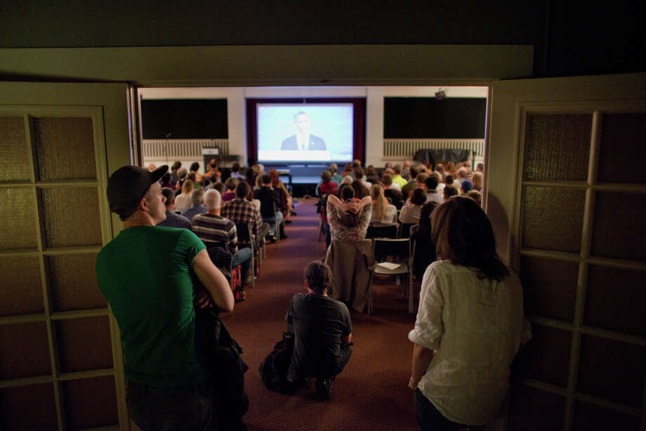 People watch during a debate party on Wednesday, October 3, 2012 at Town Hall Seattle in the First Hill neighborhood. Hundreds came out to the event at Town Hall. Photo: JOSHUA TRUJILLO / SEATTLEPI.COM