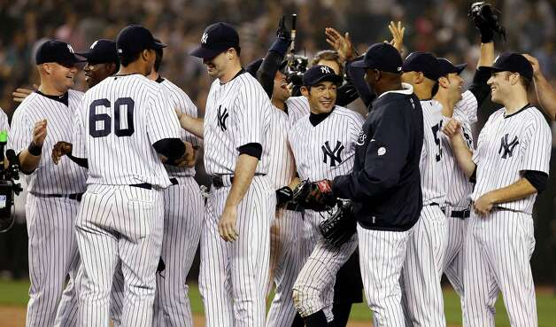New York Yankees' Ichiro Suzuki, center, of Japan, celebrates with teammates after their 14-2 win over the Boston Red Sox in a baseball game, Wednesday, Oct. 3, 2012, in New York. (AP Photo/Kathy Willens) Photo: Kathy Willens