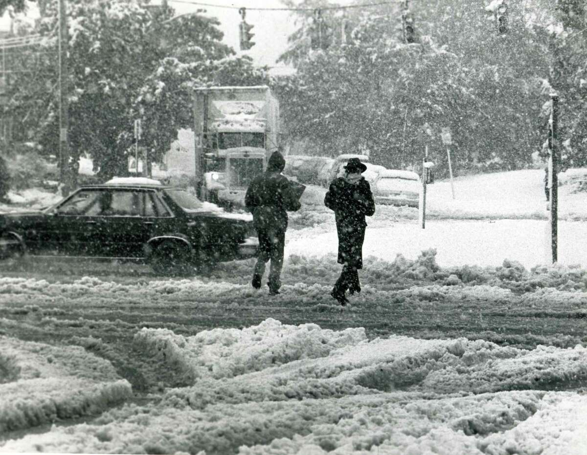 Pedestrians on their way to one of the few open food stores near Central Ave. and Manning Blvd. in Albany, N.Y., after the storm on Oct. 4, 1987. (Jack Madigan / Times Union archive)