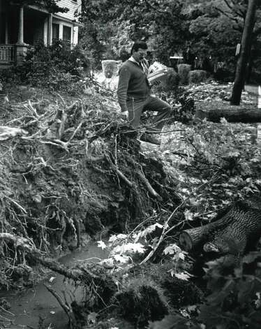 Rick Lemperle picks his way past fallen trees at the corner of Mercer St. and S. Allen in Albany, N.Y., Oct. 6, 1987, following widespread damage caused by a freak Autumn snowstorm on Oct. 4. (Paul D. Kniskern Sr. / Times Union archive)