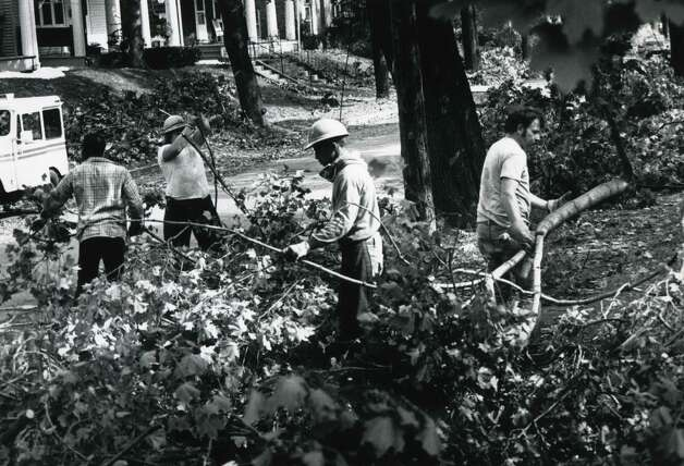 Fallen branches are cleared on Mercer St. in Albany, N.Y., Oct. 7, 1987, following widespread damage caused by a freak Autumn snowstorm on Oct. 4. (Paul D. Kniskern Sr. / Times Union archive)