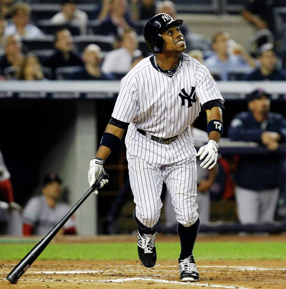 The Yankees' Curtis Granderson watches the first of his two home runs leave the park Tuesday. Photo: Kathy Willens / AP