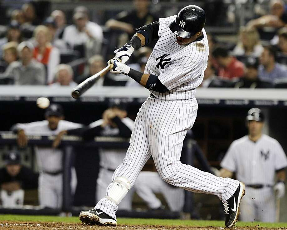 New York Yankees' Robinson Cano hits a two-RBI single during the sixth inning of a baseball game against the Boston Red Sox, Wednesday, Oct. 3, 2012, in New York. Russell Martin and Ichiro Suzuki scored on the hit. (AP Photo/Frank Franklin II) Photo: Frank Franklin II, Associated Press