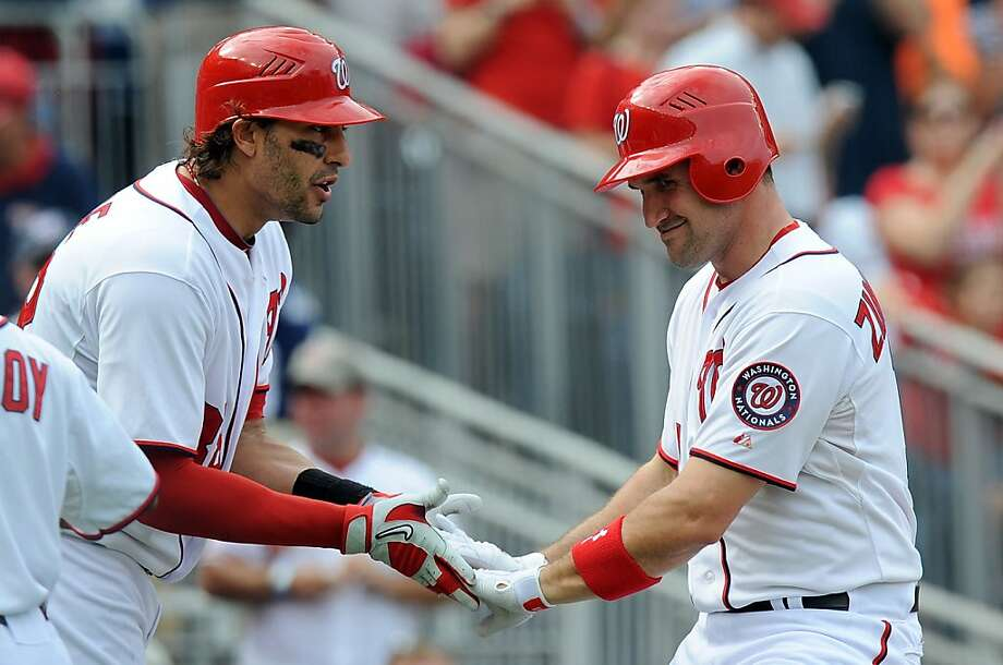 Ryan Zimmerman, far right,  homered to spark the offense. Photo: Greg Fiume, Getty Images