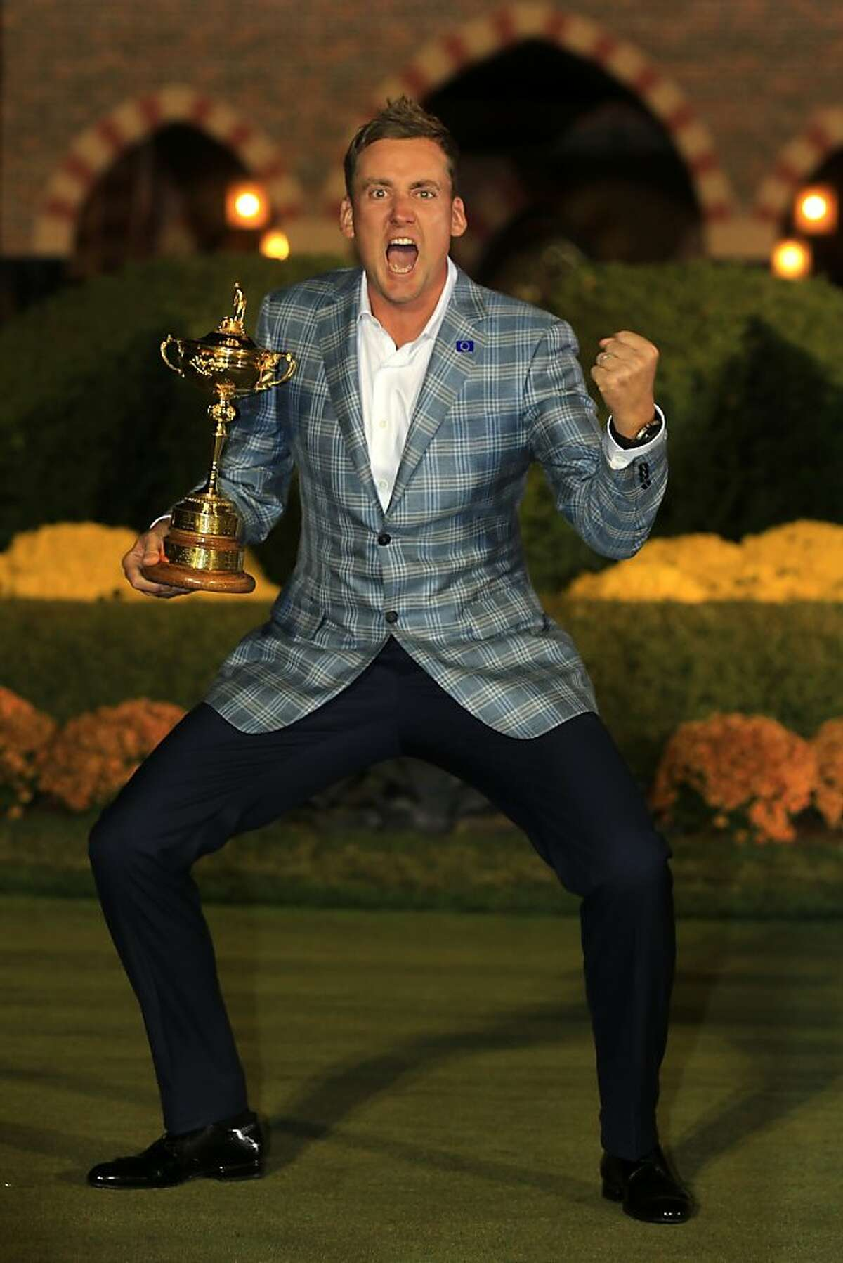 MEDINAH, IL - SEPTEMBER 30: Ian Poulter of Europe poses with the Ryder Cup after Europe defeated the USA 14.5 to 13.5 to retain the Ryder Cup during the Singles Matches for The 39th Ryder Cup at Medinah Country Club on September 30, 2012 in Medinah, Illinois. (Photo by David Cannon/Getty Images)