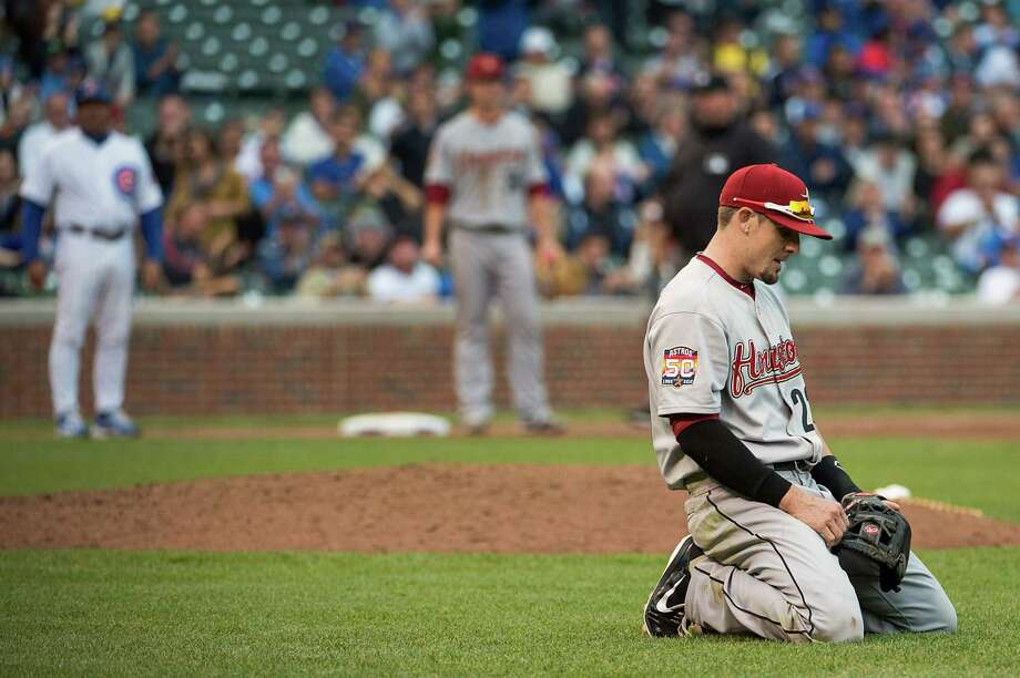 Astros second baseman Tyler Greene is unhappy he couldn't throw out the Cubs' Tony Campana and help thwart a ninth-inning rally Wednesday at Wrigley Field. Photo: Smiley N. Pool / © 2012  Smiley N. Pool