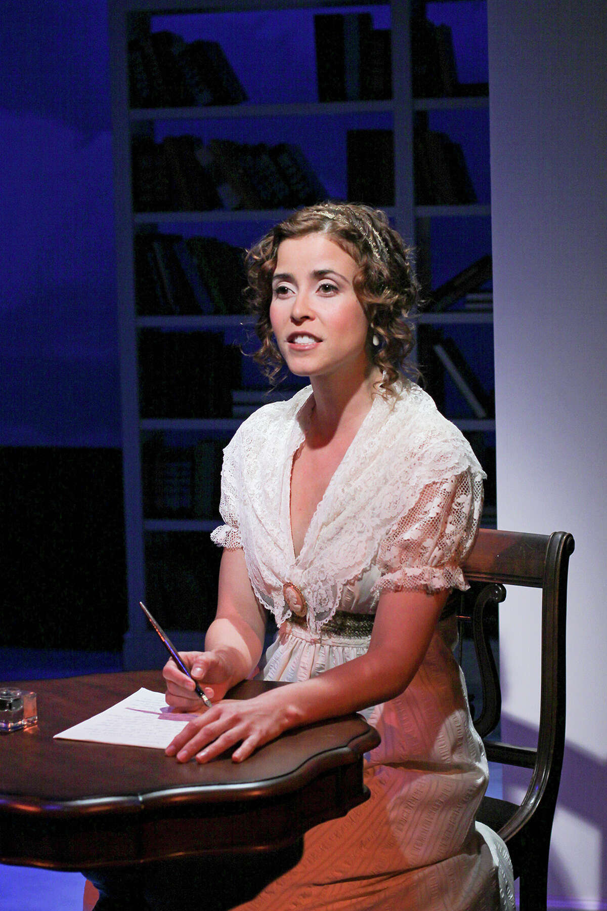 Jane Austen, played by actress Gisela Chipe, pens a letter revealing her true love in Pride@Prejudice: a romantic deconstruction, playing Sept. 28 - Oct. 28, 2012, at Capital Rep, 111 N. Pearl St, Albany. (Joseph Schuyler)