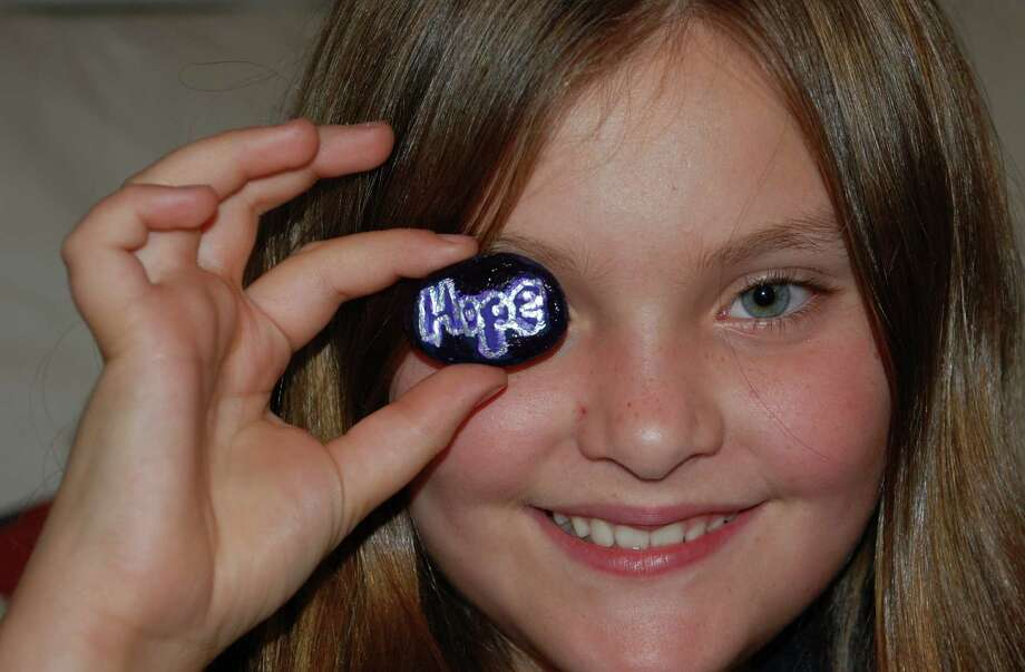 Bliss Sidell, an 11-year-old Westport girl, raised money over the summer to donate to Yale-New Haven Hospitalís neo-natal intensive care unit by selling decorated rocks through her non-profit venture, Westport Rox. Photo: Jarret Liotta / Westport News contributed
