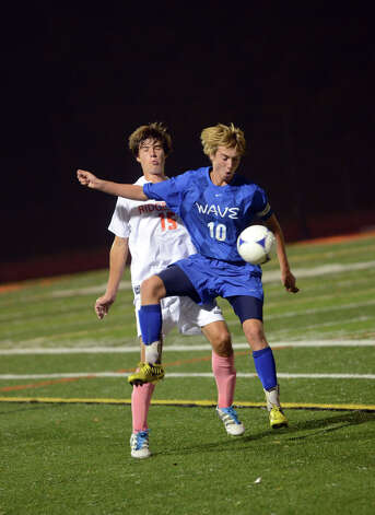 Darien's Ben Highton (10) wins the ball as Ridgefield's Alexander Northcutt (15) defends during the boys soccer game at Ridgefield High School on Wednesday, Oct. 3, 2012. Photo: Amy Mortensen / Connecticut Post Freelance