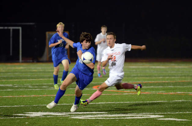 Darien's Graham Helgans (28) controls the ball during the boys soccer game against Ridgefield at Ridgefield High School on Wednesday, Oct. 3, 2012. Photo: Amy Mortensen / Connecticut Post Freelance