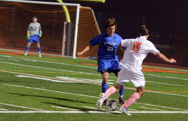 Ridgefield's Alexander Northcutt (15) tries to get around Darien's Alexei Gunya (25) during the boys soccer game at Ridgefield High School on Wednesday, Oct. 3, 2012. Photo: Amy Mortensen / Connecticut Post Freelance