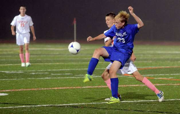 Darien's Henrik Stockinger (23) wins the ball as Ridgefield's Matthew Wilson (14) defends during the boys soccer game at Ridgefield High School on Wednesday, Oct. 3, 2012. Photo: Amy Mortensen / Connecticut Post Freelance