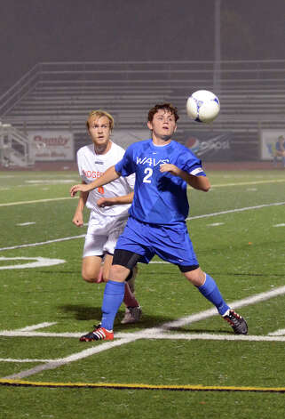 Darien's Brennan Branca (2) controls the ball as Ridgefield's Connor Findlay (6) defends  during the boys soccer game at Ridgefield High School on Wednesday, Oct. 3, 2012. Photo: Amy Mortensen / Connecticut Post Freelance
