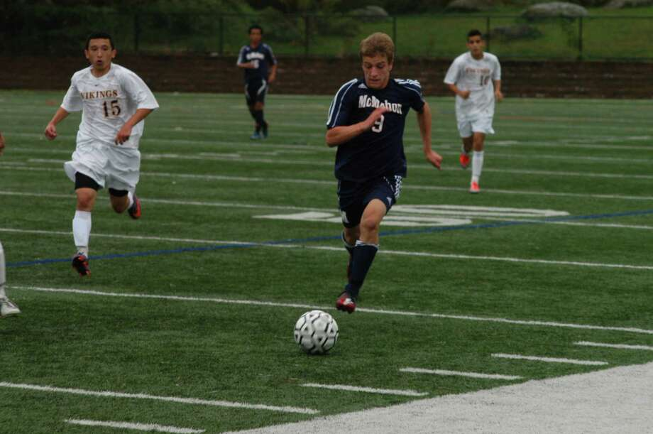 Brien McMahon's Niko Petridis races after the ball during a game against Westhill Wednesday. The FCIAC foes battled to a tie score of 1-1. Photo: Andy Hutchison