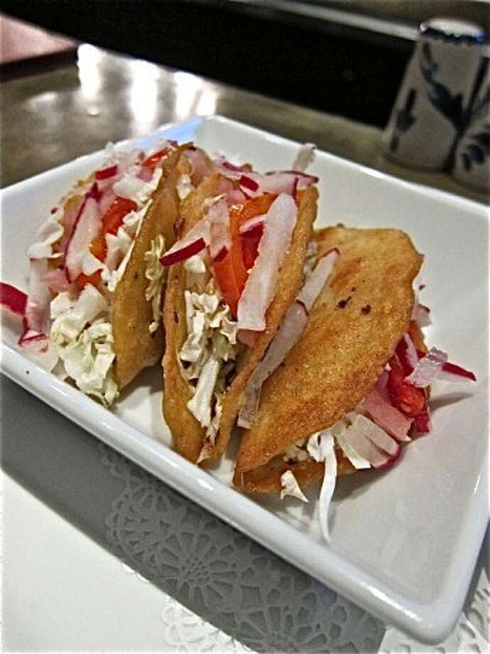 Tacos Dorados – These simple, delicious tacos are stuffed with spicy mashed potatoes and fried until their corn tortillas become puffy. You can find this Alison Cook favorite at Hugo's. Photo by Alison Cook.