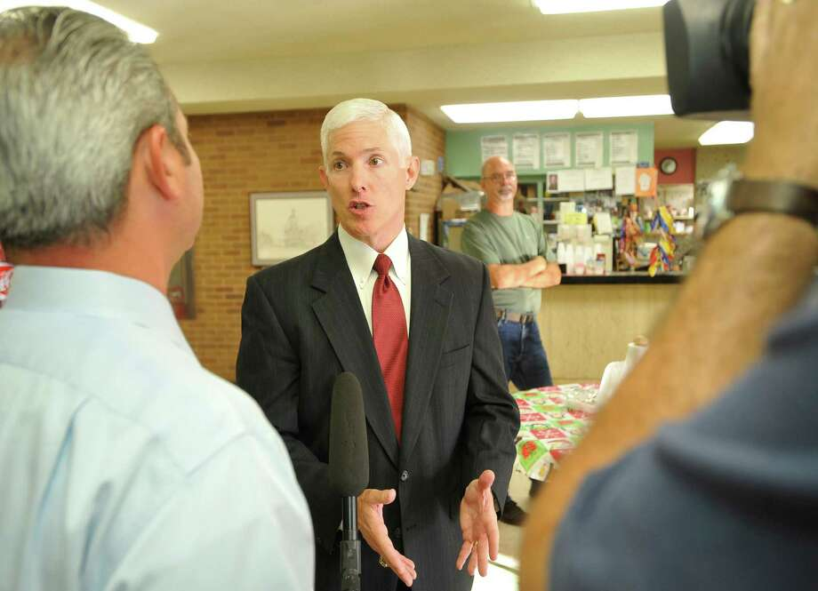 Lead Attorney David Starnes, center, talks with the out-of-town media.  Thursday morning, 356th District Court Judge Steve Thomas heard arguments from the Kountze cheerleaders and the school district regarding use of scriptures on signs at football games. He has to decide to order a temporary injunction, allowing the cheerleaders to use their signs or not. The hearing started at 9 a.m. Dave Ryan/The Enterprise