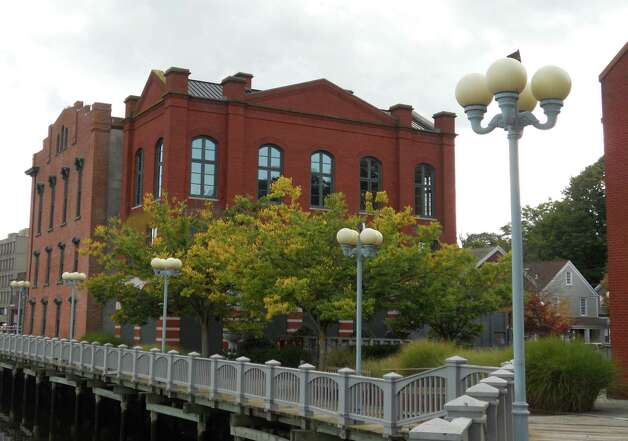 A view of National Hall on the west bank of the Saugatuck River. The downtown landmark is being redeveloped for office use by the Norwalk commercial real estate firm Greenfield Partners. Photo: Paul Schott / Westport News