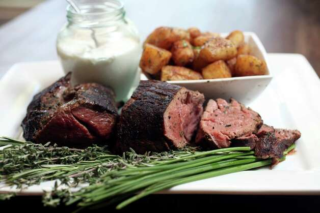 Grilled Beef Tenderloin with Horseradish Sauce by Rico Caters. October 3, 2012 Photo: Juanito M.Garza, San Antonio Express-News / San Antonio Express-News