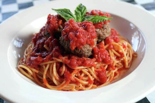 Boccata serving spaghetti and meatballs in marinara sauce, October 2, 2012 Photo: JUANITO M GARZA, San Antonio Express-News / San Antonio Express-News