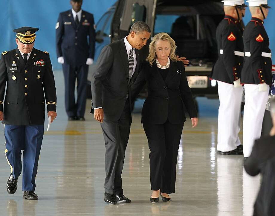 JOINT BASE ANDREWS, MD - SEPTEMBER 14:  U.S. President Barack Obama and U.S. Secretary of State Hillary Clinton walk away from the podium during the Transfer of Remains Ceremony for the return of Ambassador Christopher Stevens and three other Libyan embassy employees at Joint Base Andrews September 14. 2012 in Joint Base Andrews, Maryland. Stevens and the three other embassy employees were killed when the consulate in Libya was attacked September 11.   (Photo by Molly Riley-Pool/Getty Images)   *** BESTPIX *** Photo: Pool, Getty Images
