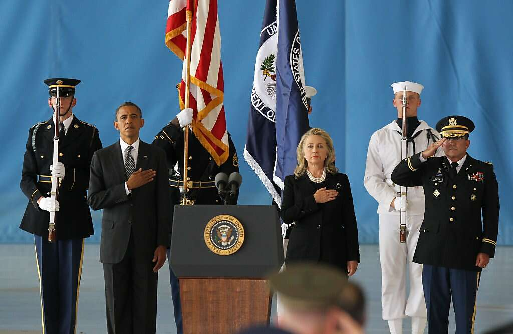 JOINT BASE ANDREWS, MD - SEPTEMBER 14:  U.S. President Barack Obama (2nd L) and U.S. Secretary of State Hillary Clinton (3rd R) hold their hands over their hearts during the Transfer of Remains Ceremony for the return of Ambassador Christopher Stevens and three other Libyan embassy employees at Joint Base Andrews September 14. 2012 in Joint Base Andrews, Maryland. Stevens and the three other embassy employees were killed when the consulate in Libya was attacked September 11.   (Photo by Molly Riley-Pool/Getty Images) *** BESTPIX *** Photo: Pool, Getty Images