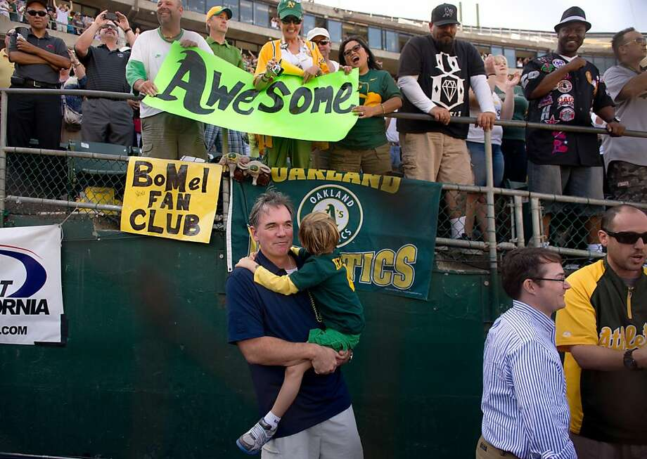 Oakland Athletics general manager Billy Beane watches his team celebrate following a 12-5 win over the Texas Rangers in a baseball game Wednesday, Oct. 3, 2012, in Oakland, Calif. With the win, the Athletics clinched the AL West title. Photo: Jose Luis Villegas, Associated Press