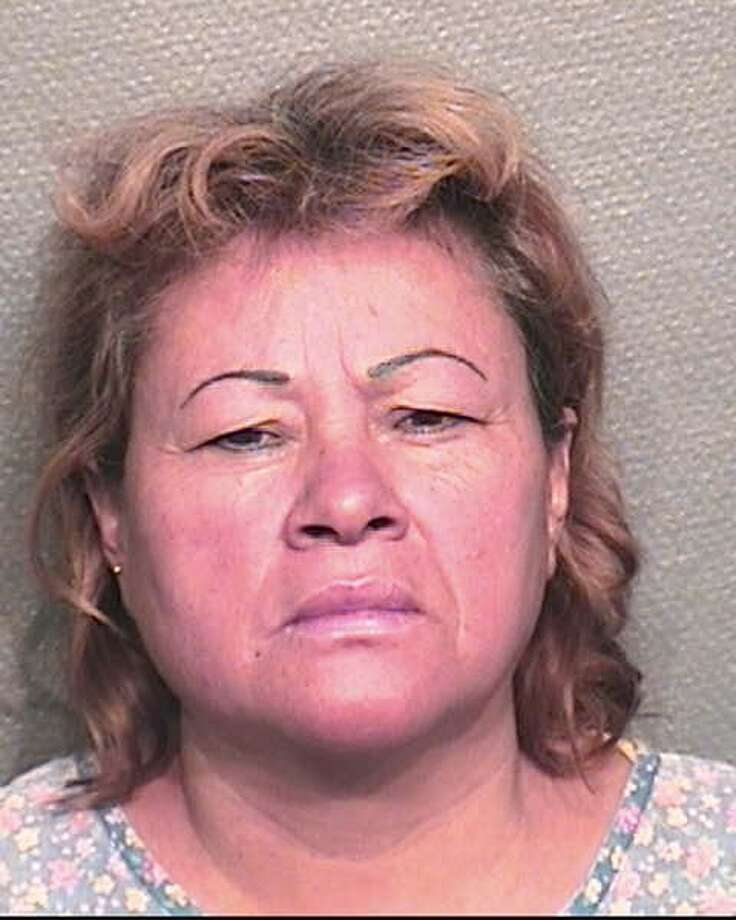 Ana Canales, 48, is accused of striking her 16-year-old daughter with a machete on multiple occasions, court records show. Photo: HPD