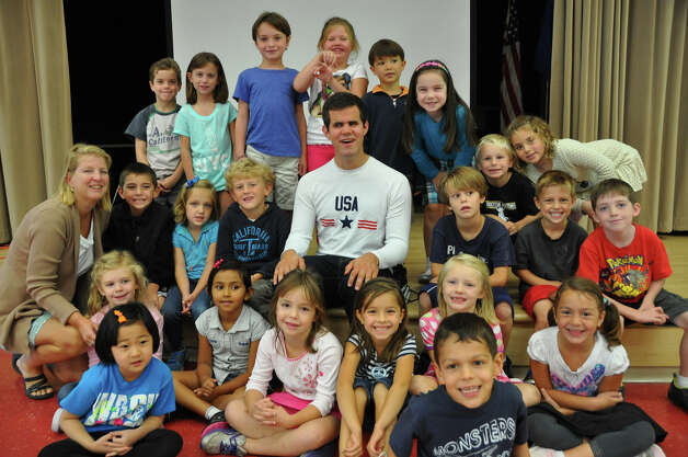 Pictured here with Andrew Johnson is Cathy Coudert and her first-grade class. Photo: Contributed