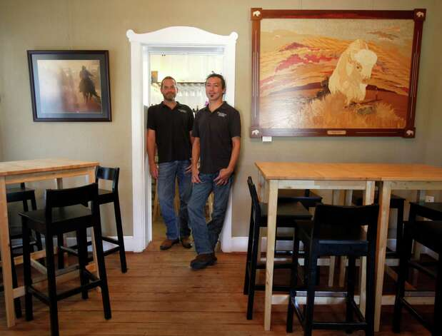Scott Haupert, left, and Manny Sileriopose Tuesday Oct. 2, 2012 in their recently opened Sandstone Cellars wine bar next to their Sandstone Cellars winery in Mason, Texas. Photo: William Luther, San Antonio Express-News / © 2012 San Antonio Express-News
