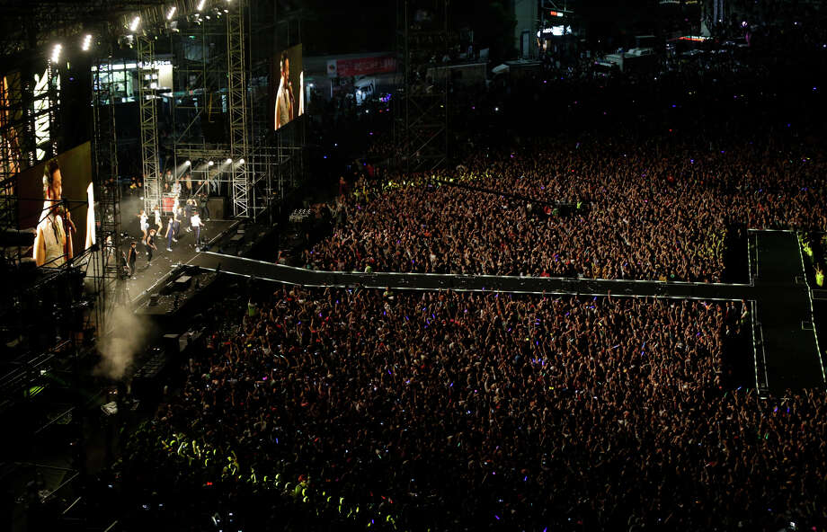 "South Korean rapper PSY, performs during his concert, in Seoul, South Korea, Thursday, Oct. 4, 2012. Rapper Psy hit the stage at a public plaza in front of Seoul City Hall for a free concert designed to thank home fans for their support of his global hit song ""Gangnam Style."" About 80,000 fans feverishly cheered and screamed ""Psy"" as he performed the signature horse-riding dance at the concert, dubbed ""Seoul Style."" The wacky song has become a global sensation sinceits July release on YouTube. (AP Photo/Lee Jin-man) Photo: Lee Jin-man, Associated Press / AP"