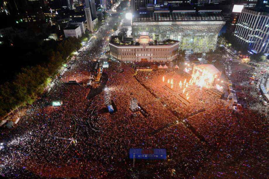 "Fans of South Korean rapper PSY, who sings the popular ""Gangnam Style"" gather during his concert in front of Seoul City Hall in Seoul, South Korea, Thursday, Oct. 4, 2012. (AP Photo/Yonhap) KOREA OUT Photo: Associated Press / YONHAP"