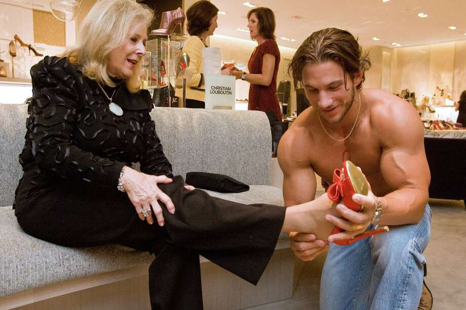 Maryann McKeithen and Shane O'Neil at the opening of the Ruby Slipper exhibit at Saks Fifth Avenue's new 10022-Shoe salon. Bill Olive for the chronicle.10/25/2008. Photo: Bill Olive / Freelance